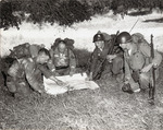 Photograph of Four Soldiers Reading a Map