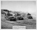 Scout Cars of the 107th Cavalry Mechanized, in Simulated Attack on an Enemy Position