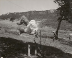 Photograph of Soldiers Running Under Fire on Training Maneuvers