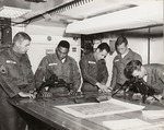 Photograph of Soldiers Examining Maps