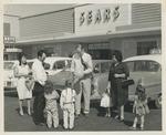Fred Farr Greeting Families Outside of a Department Store