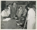 Fred Farr Observing Workers at a Fish Packing Plant, 1964