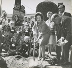 "Lady Bird Johnson Planting a Tree Outside of Colton Hall in Monterey, California, as Fred Farr and California Governor Edmund ""Pat"" Brown look on, 1966"