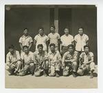 Men in front of barrack