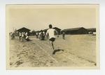 Man running on dirt track