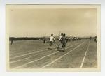 Men running on dirt track