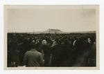 Large crowd of people outside barracks at Tule Lake